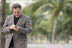 Man dialing his phone Stock Photography