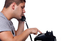 Man Dialing Old Rotary Telephone Stock Image