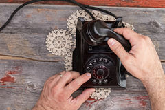 Man dialing out on an old rotary telephone Royalty Free Stock Photo