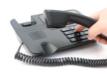 Man dialing a telephone Stock Image
