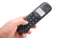 Man dialing a wireless telephone. With clipping path Royalty Free Stock Photo