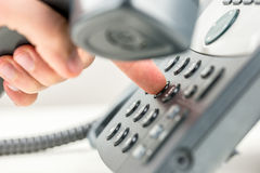 Man dialling out on a telephone Royalty Free Stock Photography