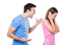 Man die bij vrouw schreeuwen Stock Foto