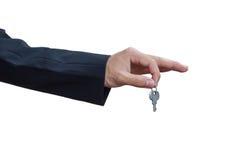 Man dient sleutel in Royalty-vrije Stock Foto's