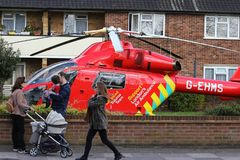 Man dies after falling off roof in Twickenham, London, England. A London Air Ambulance MD902 Explorer is seen parked in a residential garden after a 999 call had Royalty Free Stock Photos