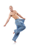 Man in dieting concept. With oversized jeans Stock Photography