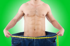 Man in dieting concept. With oversized jeans Stock Photo