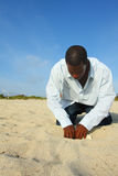 Man Digging. In the sand with blue sky background Stock Photos