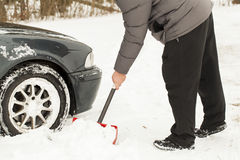 Man digging car out Royalty Free Stock Photo