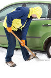 Man digging car wheels from snow Royalty Free Stock Images