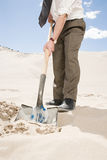 Man digging in desert Stock Photo