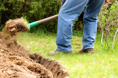 A man digging in the garden soil. Stock Photography