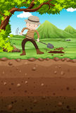 Man digging hole in the park Royalty Free Stock Photo