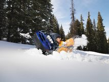 Man digging out snowmobile. Stock Photography
