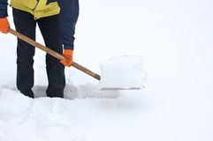 Man digging a path from snow Stock Photo