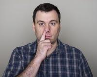 Man digging up his nose Royalty Free Stock Image