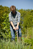 Man digging in vegetable garden Stock Photo