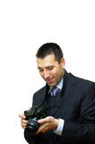 Man with digital camera smiling Royalty Free Stock Photos