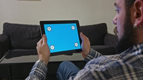 Man with a Digital Tablet with Blue Screen Motion stock video