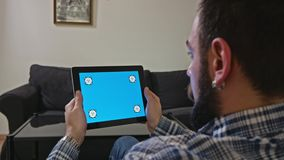 Man with a Digital Tablet with Blue Screen Motion stock video footage