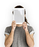 Man Digital Tablet Face Covered Copy Space Technology Concept. Man covering his face with digital tablet stock photography