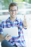 Man with digital tablet. Happy young man with digital tablet Royalty Free Stock Photos