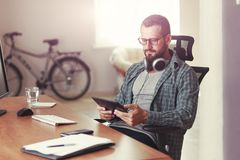 Man with digital tablet and headphones stock image
