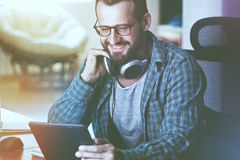 Man with digital tablet, headphones royalty free stock images