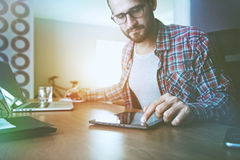 Man with digital tablet, laptop and pen at table royalty free stock photo
