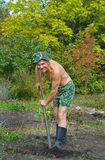 Man digs with spade 4. A man on garden digs the ground with spade Royalty Free Stock Image
