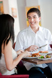 Man Dining with Partner Stock Images