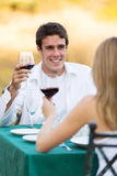 Man dinner girlfriend. Handsome young men having dinner with his girlfriend outdoors Royalty Free Stock Photo