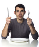 Man at dinner table isolated over white Stock Photo