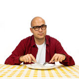 Man at the dinner table Stock Images