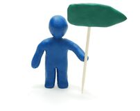 Man with Direction. 3d Person Holding Direction Arrow Sign Made of Plasticine Isolated on White Background Stock Photo