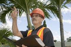 Man directs construction Stock Photos