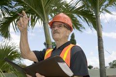 Man directs construction Stock Photos
