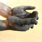 Man with dirty hands Royalty Free Stock Images