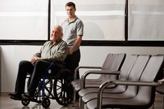 Man With Disabled Grandfather Stock Photography