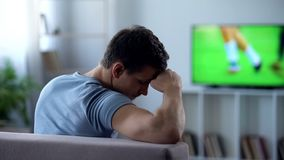 Man disappointed by football match broadcast, poor quality of digital television. Stock photo stock photography