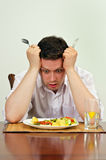 Man is disappointed with his dish Stock Photos