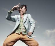 Man disco dancing. On a blue sky Stock Image
