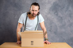 Man is discontent with his delivery Royalty Free Stock Photography