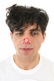 Man with discount sticker on nose Royalty Free Stock Image