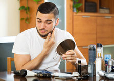 Man discovering his first wrinkles Stock Photography
