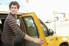 Man Disembarking Taxi While Looking Away Stock Photography