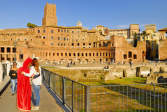 A MAN DISGUISED BY ROMAN CENTURION PERFORMS ON PAYMENT FOR TOURISTS. ROMAN FORUM, ROME, ITALY. Royalty Free Stock Images