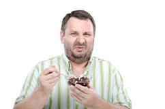 Man is disgusted by beetroot salad Royalty Free Stock Photography