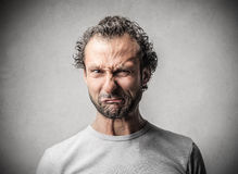 Man with a disgusted expression. Grumpy man with a disgusted expression royalty free stock photo