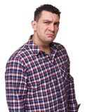 Man disgusted. Man with disgusted expression wearing plaid shirt and looking at you. Isolated on white background Stock Images